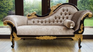 Ornate medium sized chaise longue mahogany frame with gold detailing with mink crushed velvet upholstery