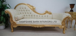 large chaise longue with gold leaf frame and ivory fabric and crystal buttons