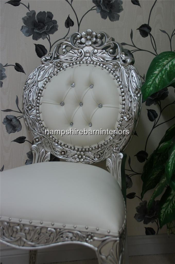 An Avalon Ornate Silver Leaf Chair Upholstered In