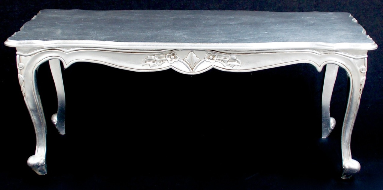 a gold or silver large leaf ornate chateau style coffee table