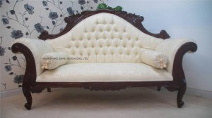 Antique replica Charles Louis cuddler sofa chaise in mahogany with ivory cream damask fabric . Ornate double ended chaise longue complate with two roll cushions