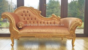 A Belle Medium sized Hampshire chaise with gold leaf frame and a luxury gold patterned velvet fabric