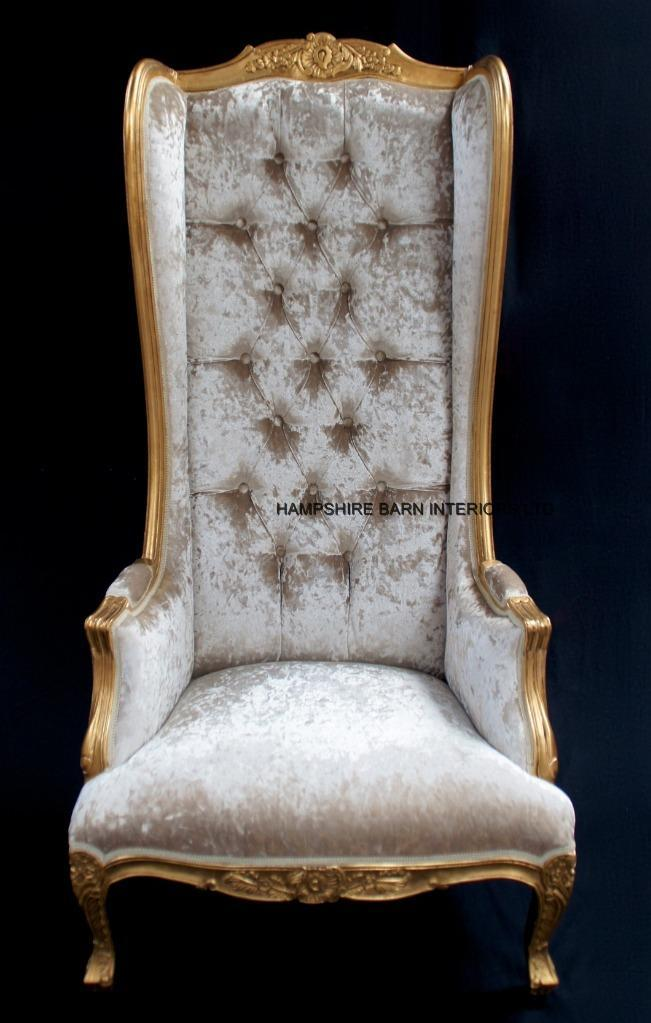 A GOLD ORNATE HIGH BACK PORTERS ARM CHAIR IN GOLD LEAF AND MERCURY CRUSHED  VELVET