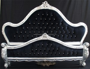 A Charles French Louis Style Bed In Silver Leaf and upholstered in black velvet with CRYSTAL buttoning