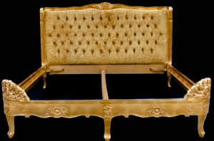 A French Louis Versailles Style Bed shown in Gold Leaf with Champagne Crushed Velvet Upholstery