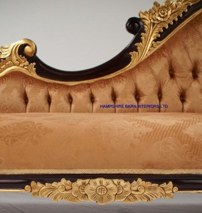 ORNATE MAHOGANY AND GOLD LEAF CHAISE WITH GOLD VELVET PATTERNED FABRIC