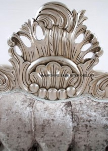 A CANNES ORNATE BED IN SILVER LEAF WITH SILVER MERCURY CRUSHED VELVET AND CRYSTAL BUTTONS