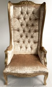 A GOLD ORNATE HIGH BACK PORTERS ARM CHAIR IN GOLD LEAF APALE GOLD BARLEY COLOUR CRUSHED VELVET