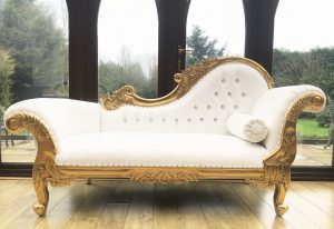 gold and white chaise longue